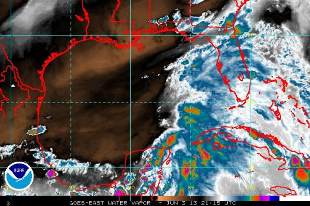 Water vapor satellite image taken of the Gulf of Mexico on 21:15Z. Notice the areas of dry air (brown and black colors) being injected towards Invest 91L.